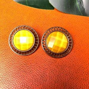 Canary yellow statement earrings.